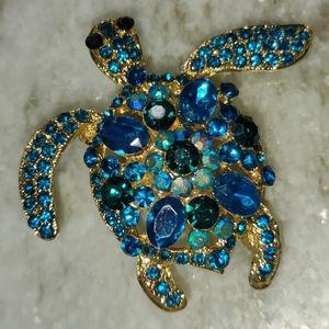 Blue and black rhinestone gold tone turtle pin